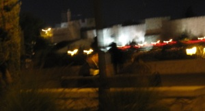 If you look carefully below the Old City walls that are lit for the Jerusalem Festival of Lights, you can make out the man on the left and the girl on the right